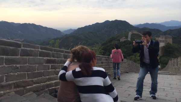 Camille photographed with strangers on Great Wall
