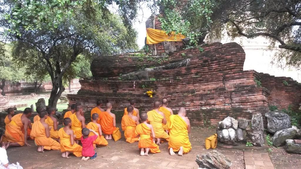 Group of praying monks at Wat Sri Sanphet temple, Ayutthaya, Thailand