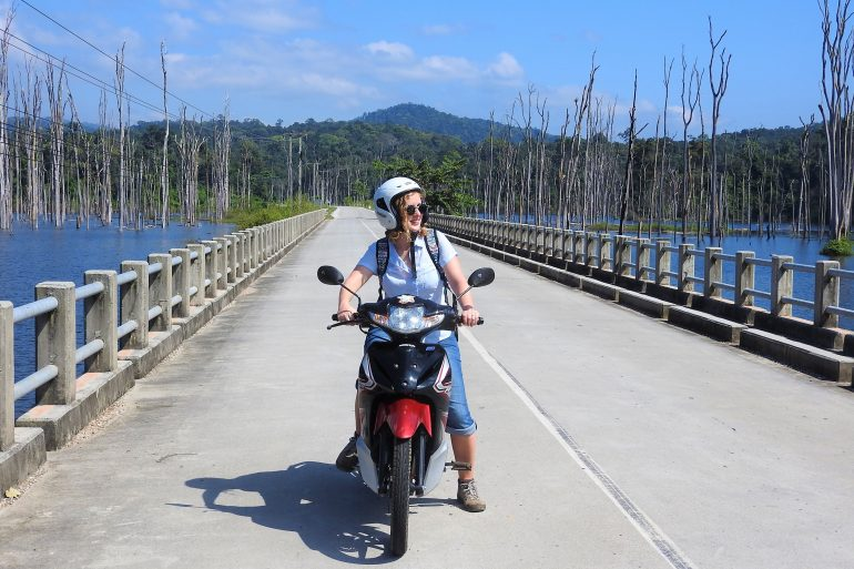 travel girl riding scooter motorbike trip Laos