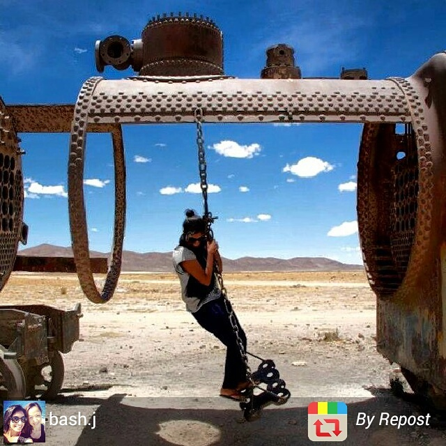 Playing on abandoned trains in Uyuni train cemetery, Bolivia