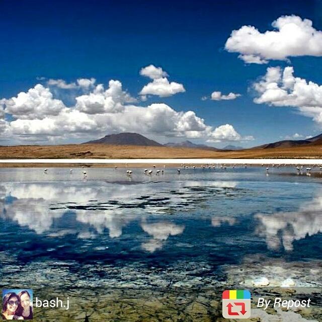 Mountain island reflections at Salar de Uyuni, Bolivia