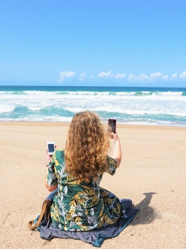 Camille on the beach with Vision Global WiFi best pocket wifi rental for travelers
